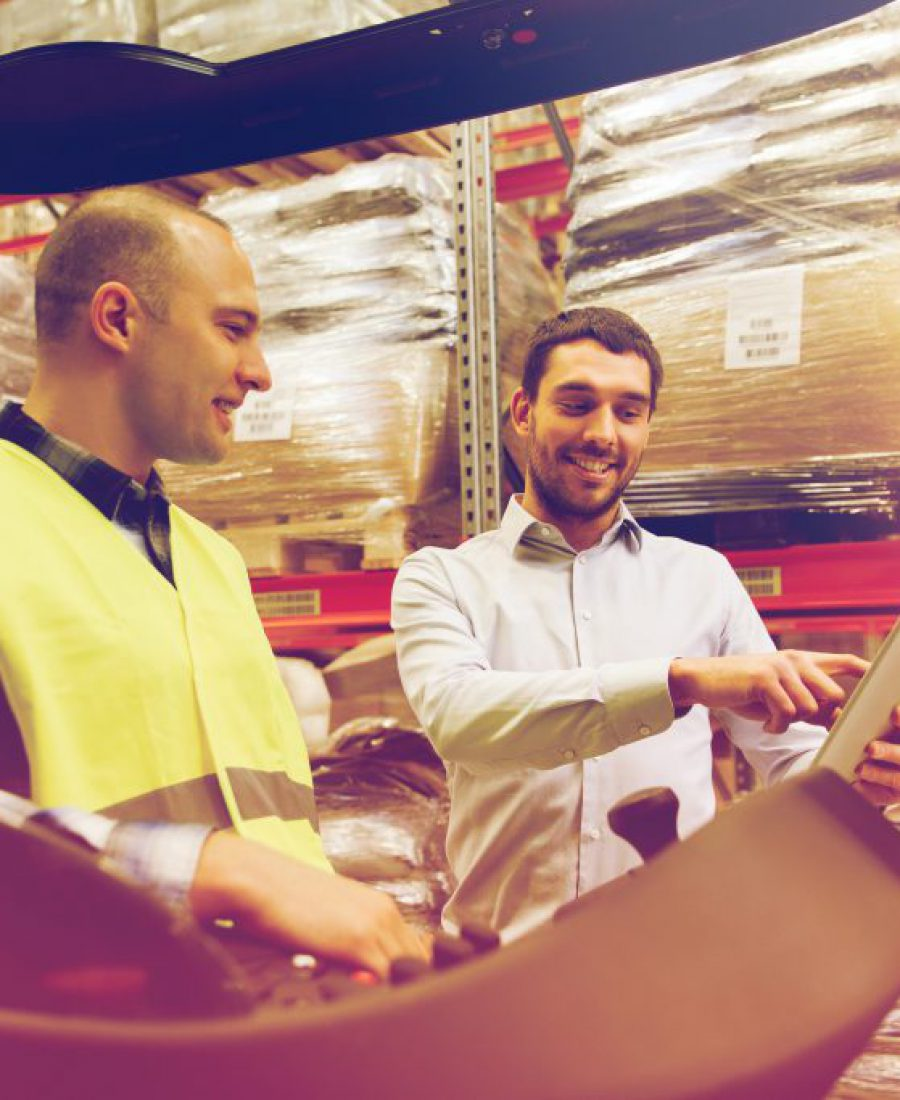happy-men-with-tablet-pc-and-forklift-at-warehouse-PR2CLBG-1024x683-1
