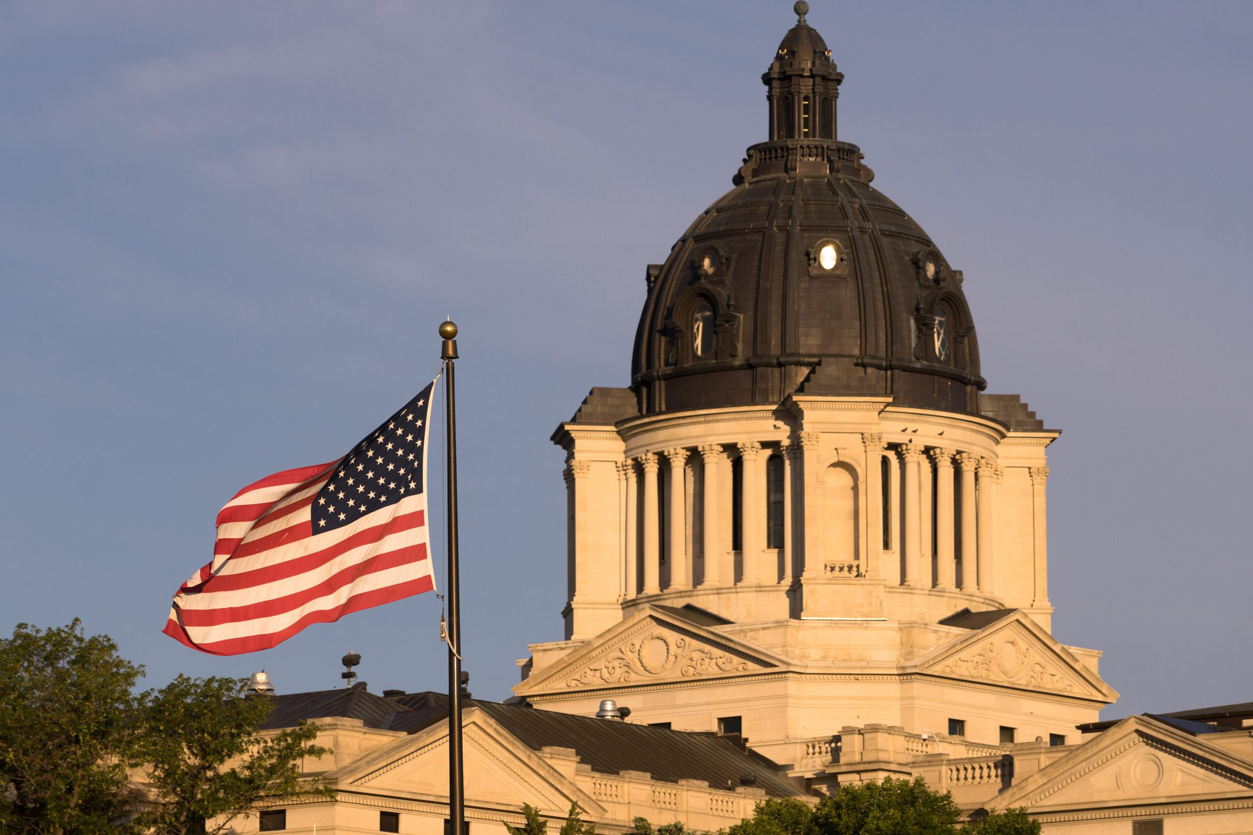 The American Flag waves in front of the capitol dome in Pierre, SD